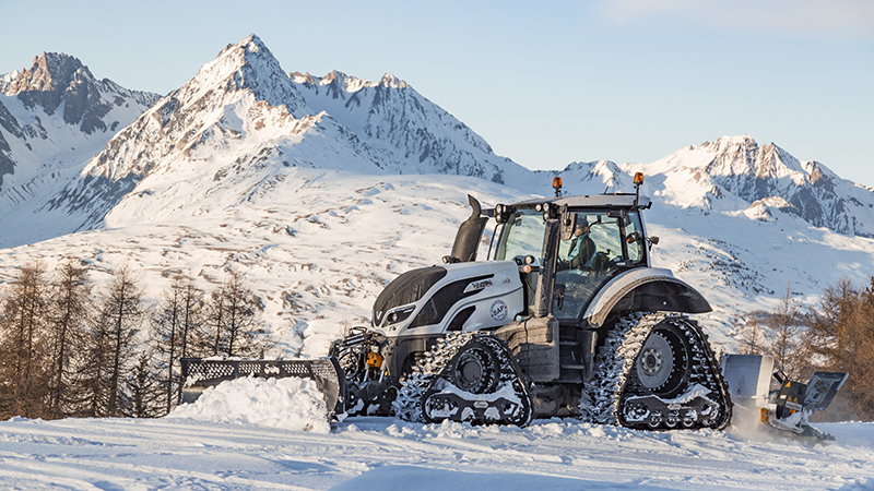 valtra unlimited customised tractor at an airport at snow work